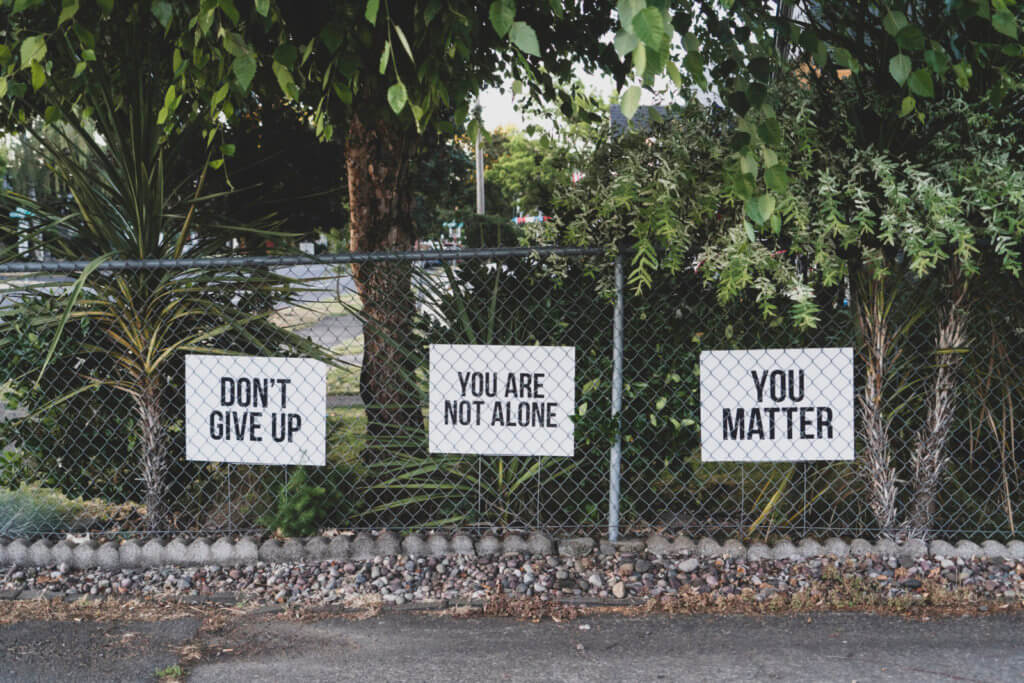 Motivational signs on a fence