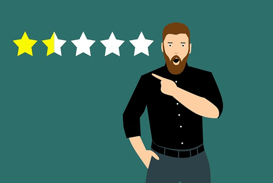 Shocked man pointing at 1.5 star review. Improve your customer experience!