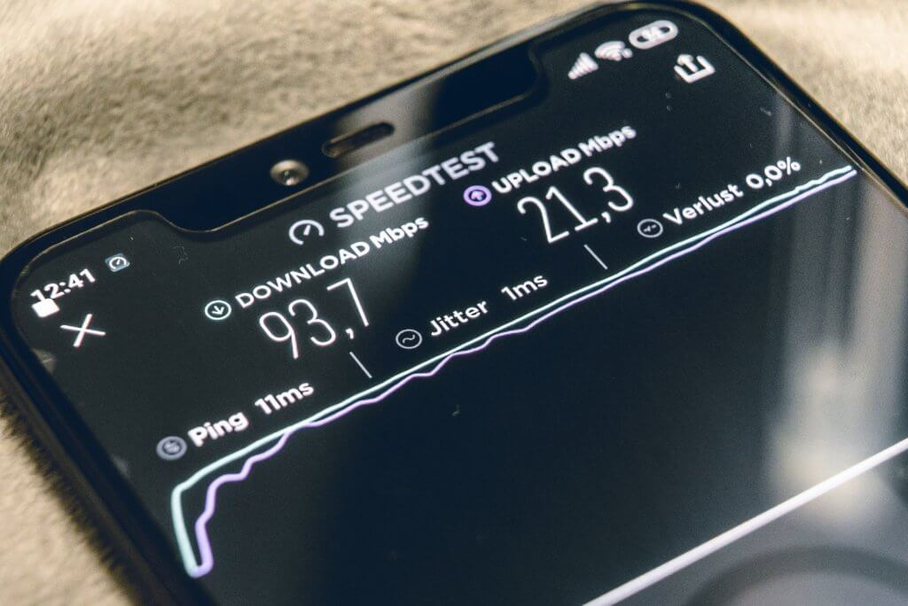 close up of a smartphone showing a speed test on screen