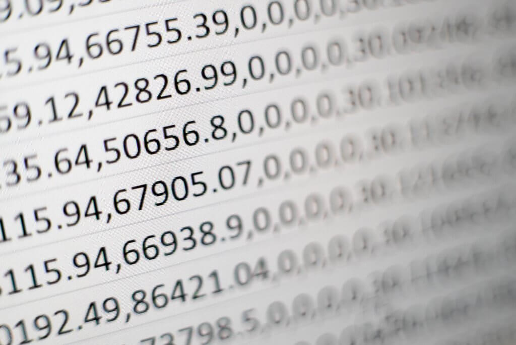 white printing paper with comma-separated numbers