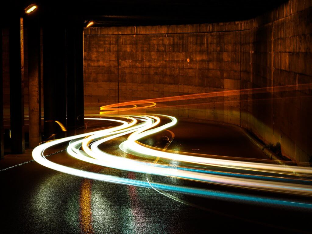 time-lapsed of street lights signifying speed
