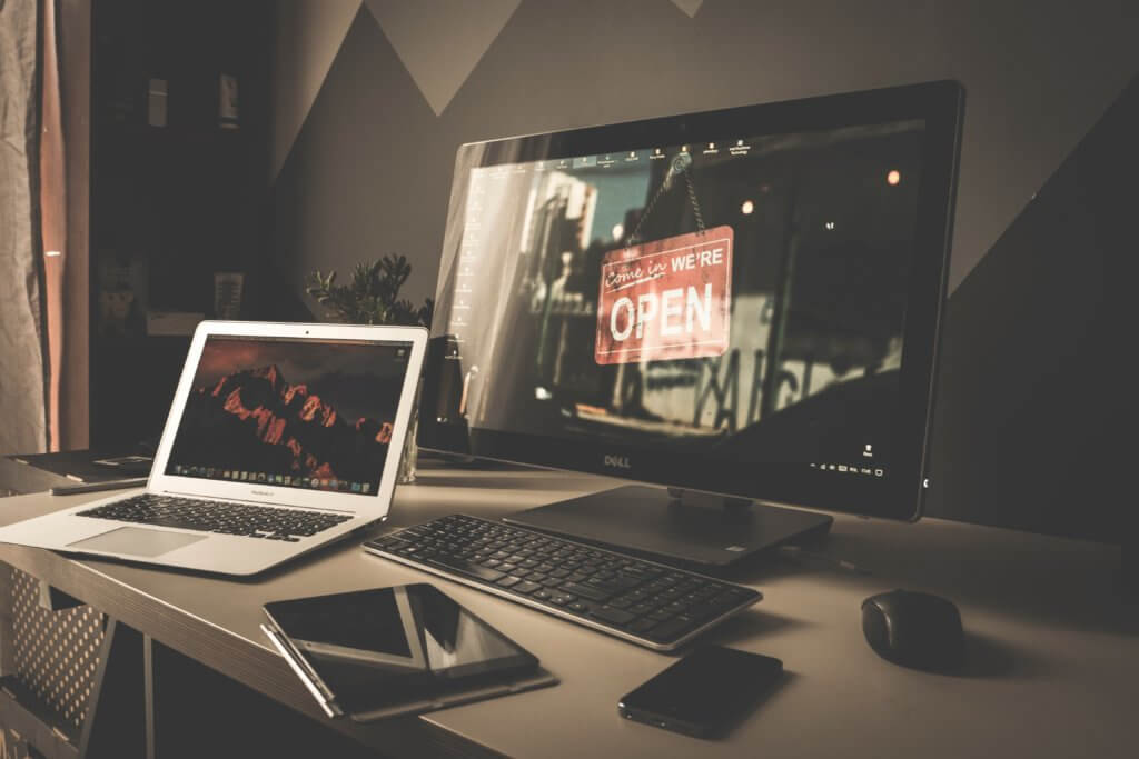 MacBook Pro setup showing one of the best monitors for graphic design in 2021