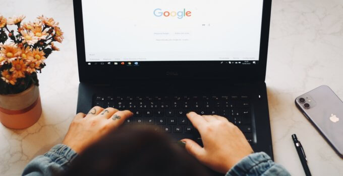 person using black laptop computer to install Google Chrome SEO extensions